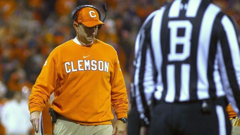 Swinney lowers his head after speaking with an official Saturday night (Photo by Josh Kelly, USAT)