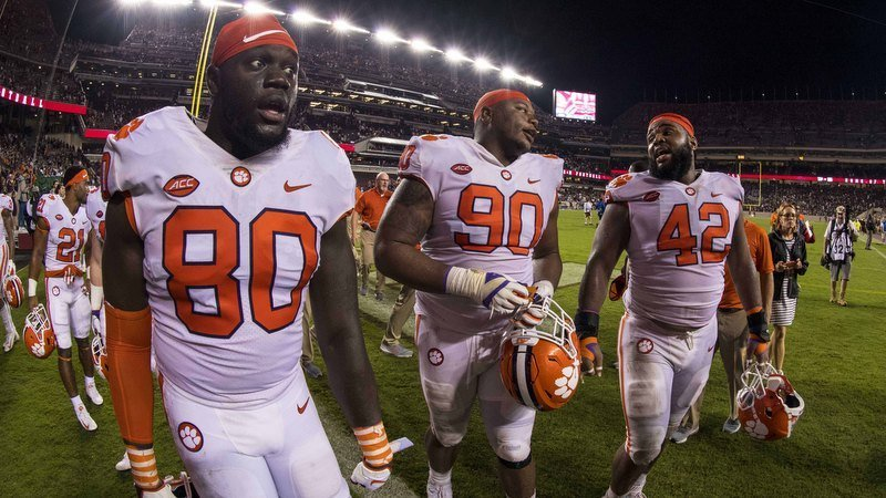Clemson players walk off the field after the win over A&M (Photo by Jerome MIron, USAT)
