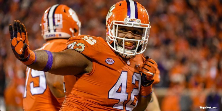 Christian Wilkins shows a Heisman pose after his first half touchdown