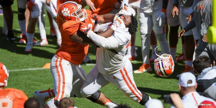Christian Wilkins has his helmet ripped on during the 1 on 1 part of Paw Drill.
