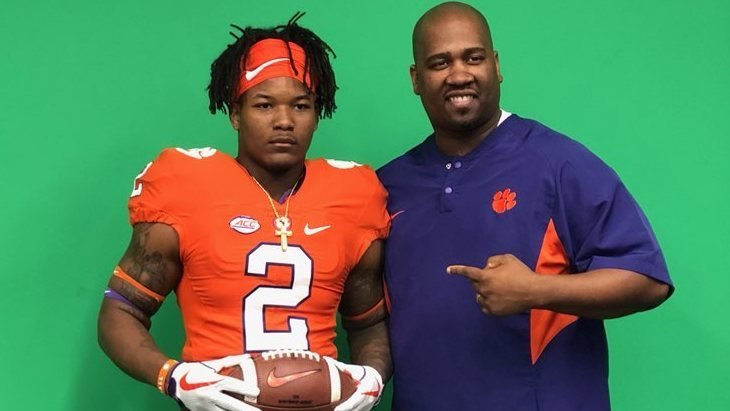 Bentley poses with area recruiter Todd Bates