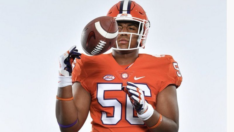 Boateng poses in a Clemson uniform last March