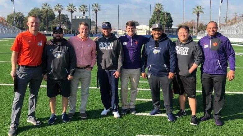 The Clemson and Bosco coaches pose Tuesday at the high school