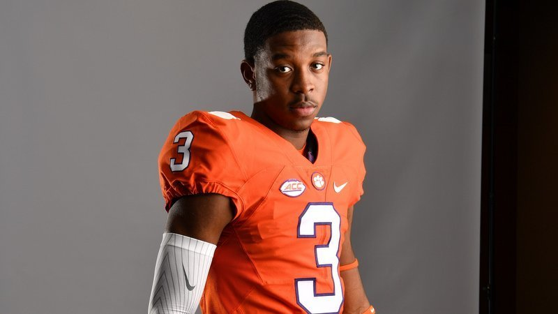 Flowers poses in a Clemson uniform