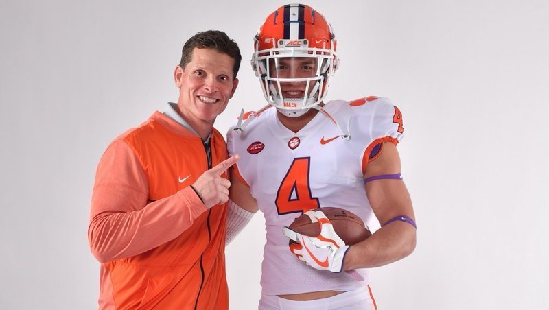 Maguire poses with defensive coordinator Brent Venables