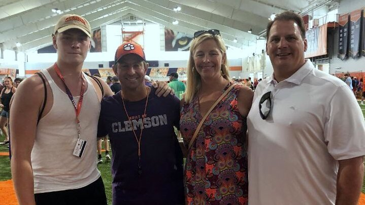 Parks and his family pose with Clemson head coach Dabo Swinney