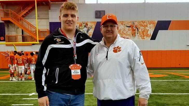Putnam poses with offensive line coach Robbie Caldwell