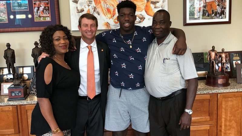 Reuben poses with his family Sunday after committing