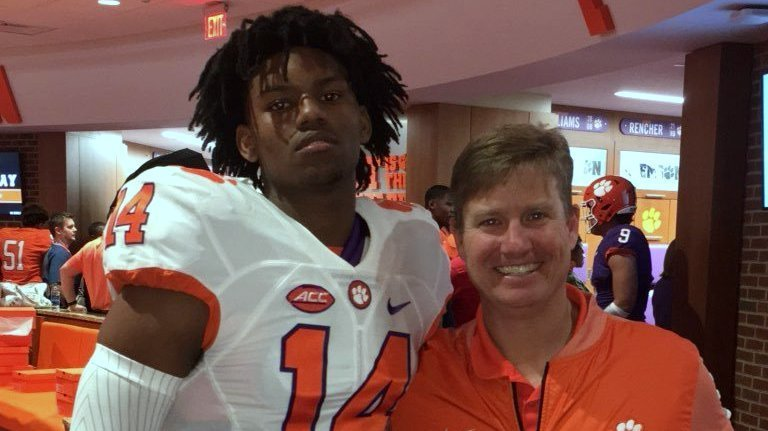 Kevin Swint poses with secondary coach and area recruiter Mickey Conn