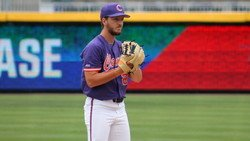 Tigers punch Louisville, possible ticket to NCAA Tourney as Clark pitches gem