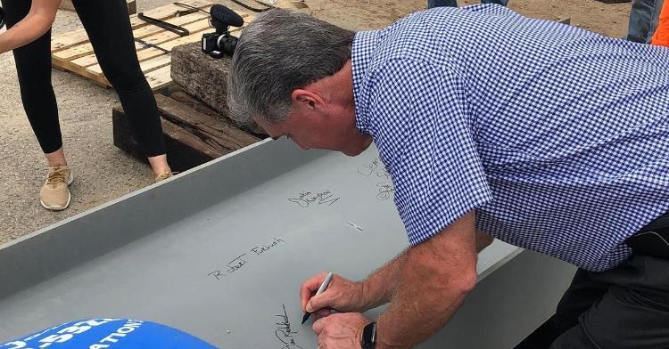 Athletic Director Dan Radakovich signs the last beam on Clemson's softball stadium