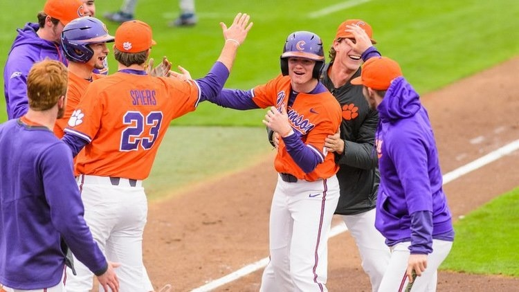Elijah Henderson is swarmed by his teammates after scoring the game-winner (Photo by David Grooms)