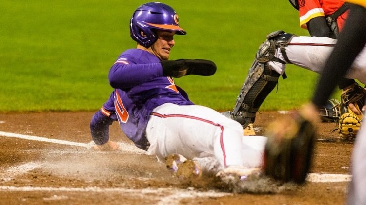 Sharpe slides home with the Tigers' first run (Photo by David Grooms)