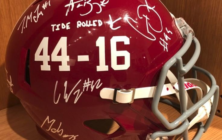 LOOK: Former Clemson players sign Alabama helmet 'Tide Rolled 44-16'
