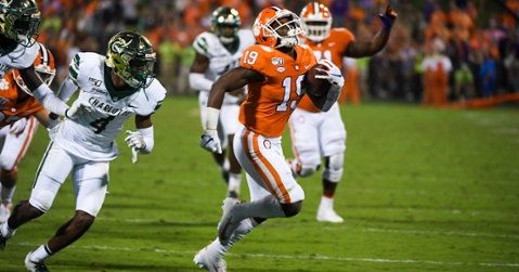 Reserve running back Mikey Dukes scores a touchdown against Charlotte.