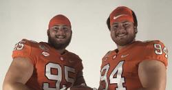 Clemson D-line twins put on scholarship