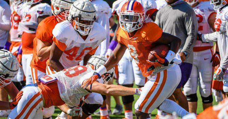 Travis Etienne escapes a tackle during Thursday's W drill.
