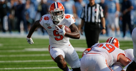Etienne looks for running room in the first half. (USA TODAY Sports-Neil Redmond)