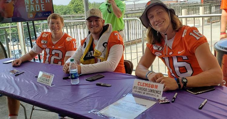 Lawrence (R), Chase Brice (Middle) and Ben Batson (L) wait on the fans