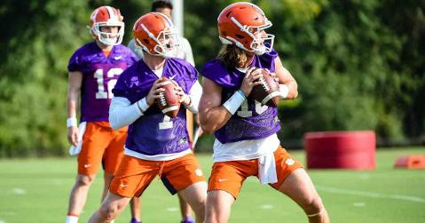 Trevor Lawrence and Chase Brice throw during an earlier practice