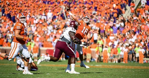 Trevor Lawrence winds up to throw in the first half