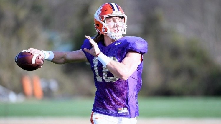 Trevor Lawrence throws a pass during Monday's practice