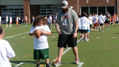 Sean Pollard gives instruction to a young camper