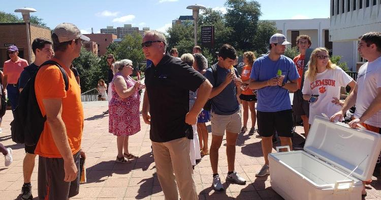 Former college coach and now ACC Network analyst Mark Richt was among a group with some giveaways for students Wednesday.