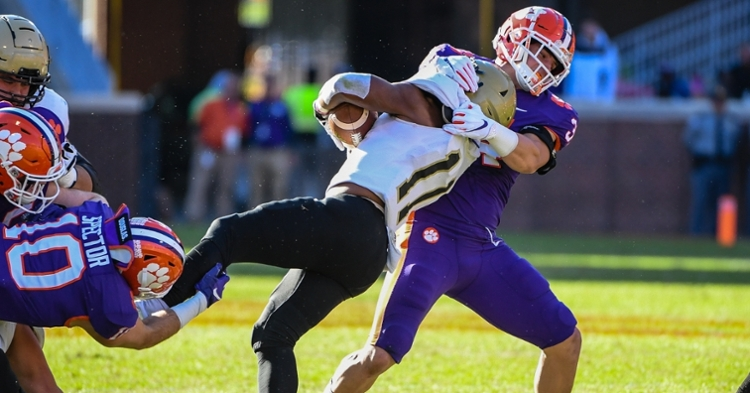 Logan Rudolph takes a Wofford ballcarrier to the ground.