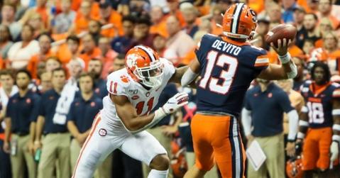 Simmons takes aim at Syracuse quarterback Tommy DeVito Saturday (Photo by Susan Lloyd)