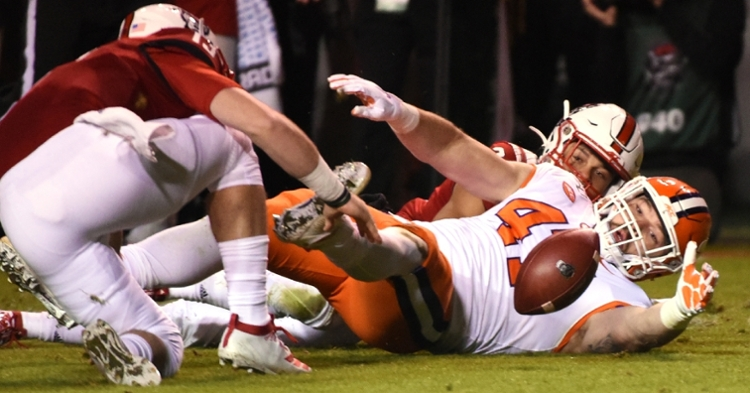 Skalski reaches for the fumble he forced Saturday night (Photo by Rob Kinnan, USAT) (Photo: usat / USATODAY)