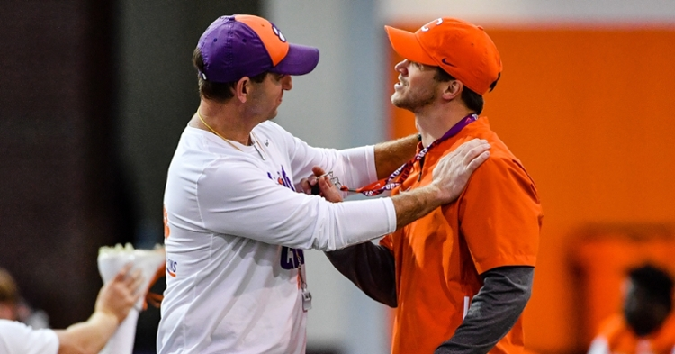 Grisham (right) gets some advice from head coach Dabo Swinney.