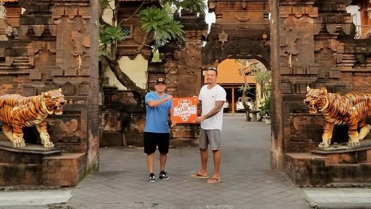 Showing off the Clemson flag at a temple in Bali