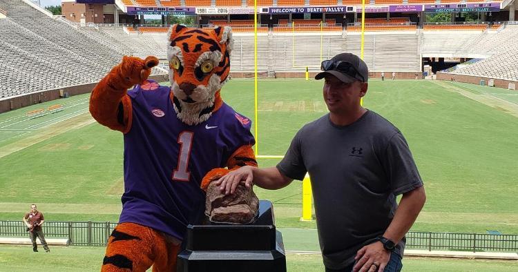The Tiger poses with a veteran at Howard's Rock Thursday