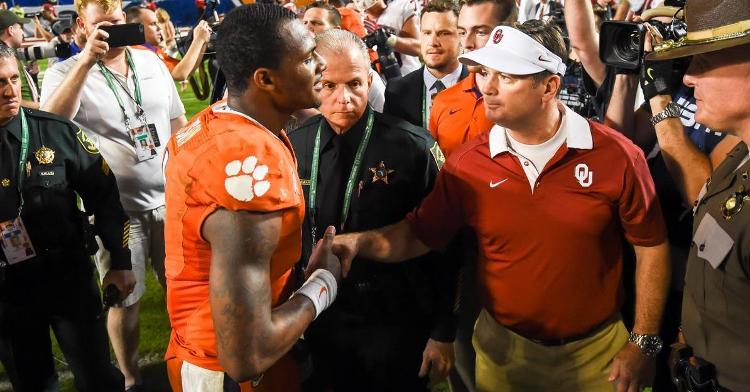 Deshaun Watson greets OU head coach Bob Stoops after the game