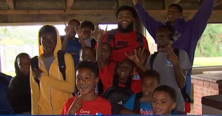 WATCH: Christian Wilkins gives backpacks to kids