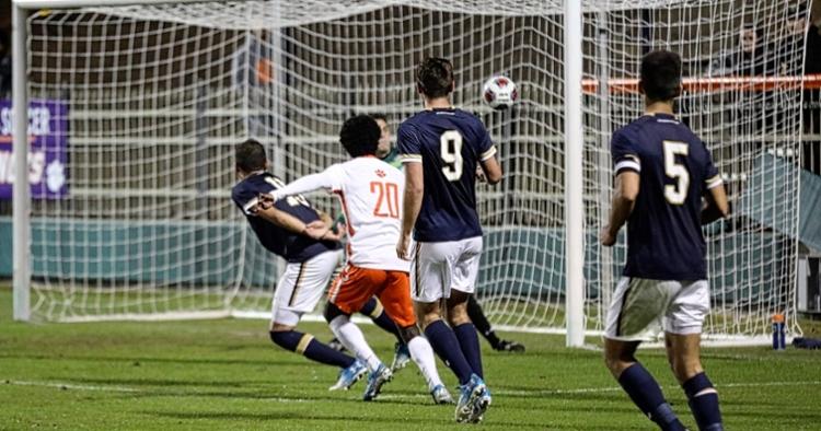 #20 Phillip Mayaka scores a goal against Notre Dame (Credit: Allen Hodges)