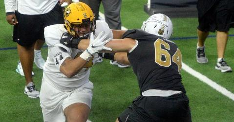Bryan Bresee takes on an offensive lineman last week at The Opening Finals