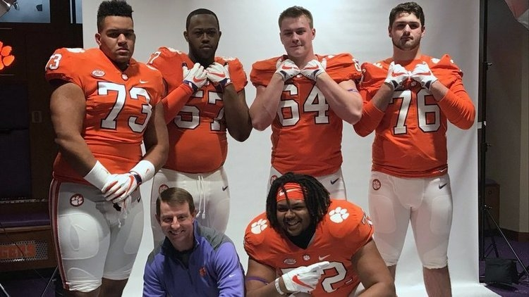 Clemson head coach Dabo Swinney poses with the offensive line prospects