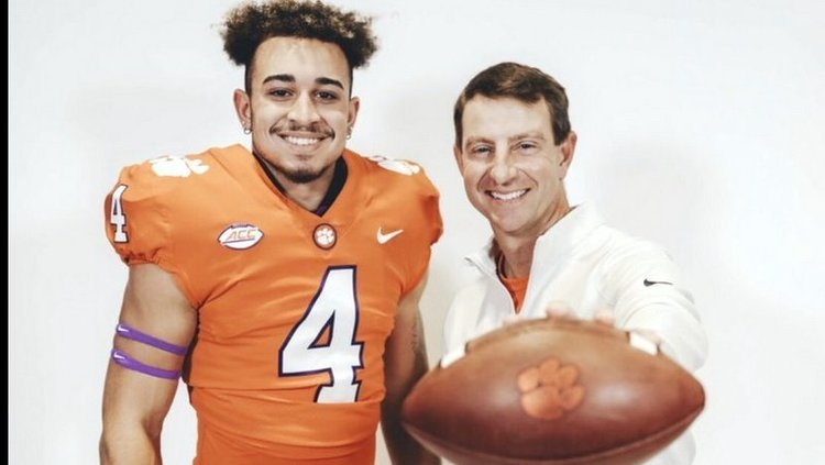 Fleming poses with head coach Dabo Swinney during his visit
