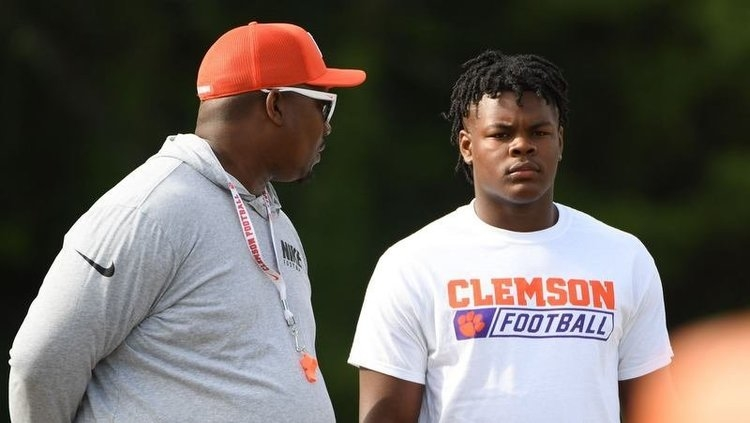 Perry works out with Todd Bates at Swinney's camp last year.