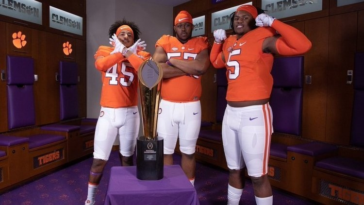 Recruits pose with the National Championship trophy