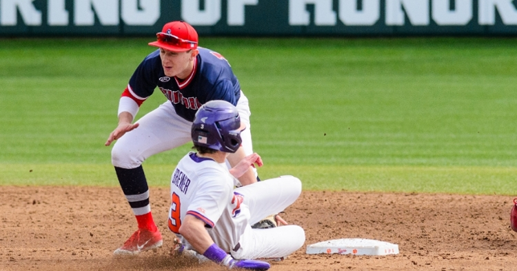Dylan Brewer slides under the tag early in the game (Photo by David Grooms)
