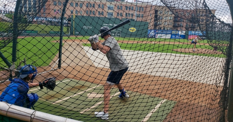Logan Davidson takes his cuts Monday at Fluor Field in Greenville.