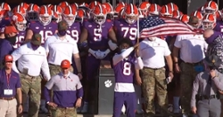 WATCH: Justyn Ross with American flag leads Tigers down hill
