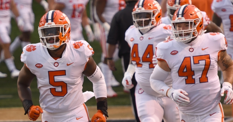 KJ Henry, left, led Clemson's defensive ends group in snaps.