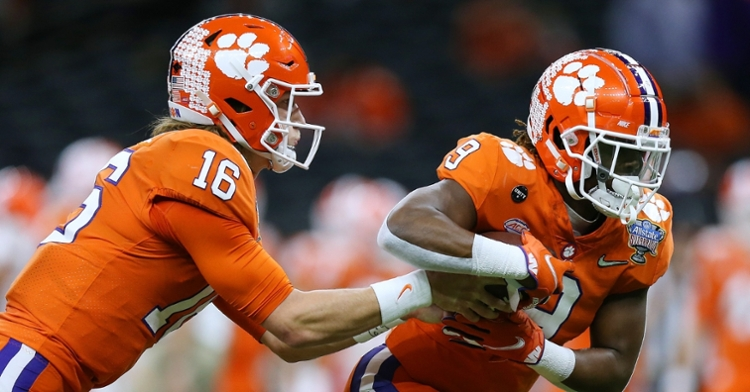 Lawrence hands the ball to Etienne in the first half of the Sugar Bowl
