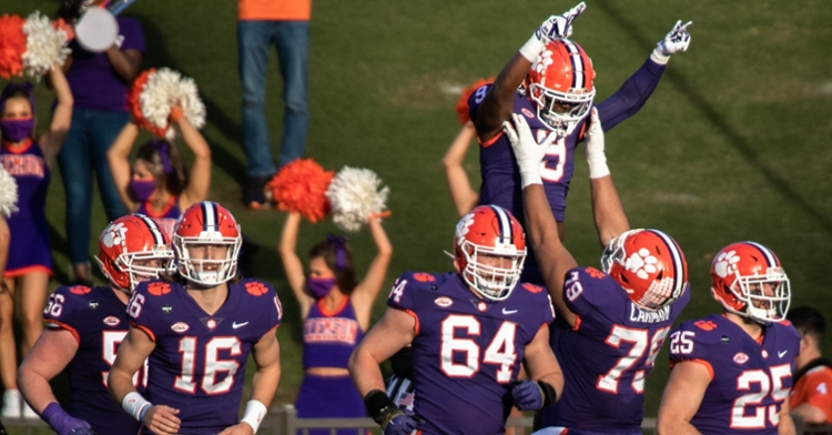 The offensive line celebrates with Travis Etienne. (Photo courtesy ACC)