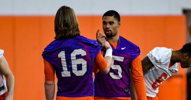 Trevor Lawrence and DJ Uiagalelei share a special handshake before practice