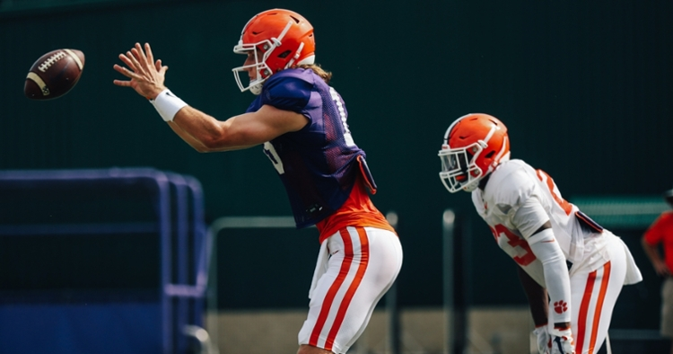 Trevor Lawrence takes a snap during practice. (Photo courtesy of CU Athletics)